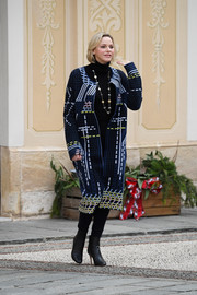 Charlene Wittstock bundled up in a geometric-patterned tweed coat for the Christmas gifts distribution at Monaco Palace.