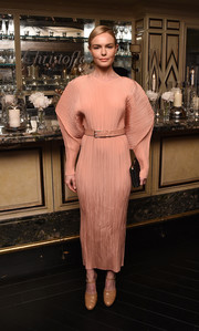 Kate Bosworth was futuristic-chic in a bold-sleeved peach midi dress by Jil Sander at the launch of Idole de Christofle.