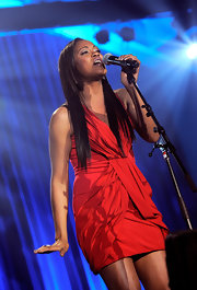 Shontelle performed in a stunning red cocktail dress. The vintage draping and the brilliant color were perfect for the songstress. She was performing at the Reeve Foundation's Magical Evening Gala.