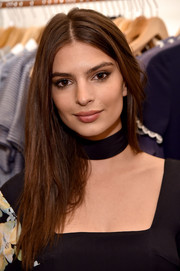 Emily Ratajkowski wore her hair with a center part and choppy layers at the launch of her dress collaboration with Christy Dawn.
