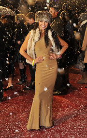 Lizzie dons a fur vest over a gold one shoulder dress at the 'Narnia' premiere. She completes her look with a fur hat.