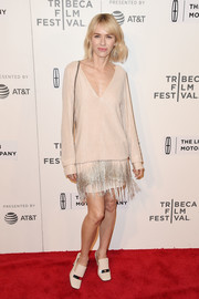 Naomi Watts complemented her dress with a pair of nude loafer heels by Sergio Rossi.