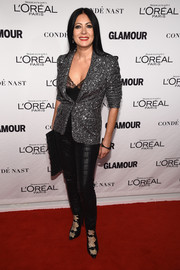 Catherine Malandrino layered a sequined silver jacket over a lacy black top for the Glamour Women of the Year Awards.