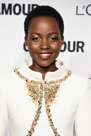 Lupita Nyong'o looked radiant with her shimmering beauty look at the Glamour Women of the Year Awards.
