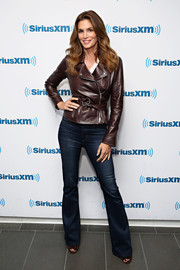 Cindy Crawford was fall-chic in a belted brown leather jacket while visiting SiriusXM.