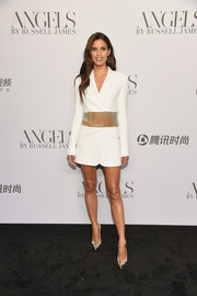 Sara Sampaio kept it fun in a white Azzaro Couture tux dress with a sheer midsection at the 'Angels' by Russell James book launch.