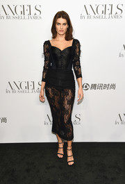 Isabeli Fontana looked sensual in a black Dolce & Gabbana corset dress with a sheer skirt and sleeves at the 'Angels' by Russell James book launch.