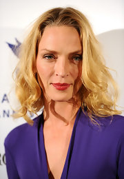 Uma Thurman spiced up her look with a swipe of juicy red lip gloss.