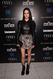 Jennifer Connelly wore a custom Louis Vuitton mini dress, featuring a leather bodice and a beaded skirt, to the screening of 'Captain America: Civil War.'