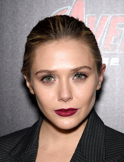 Elizabeth Olsen brushed her locks back into a classic bun for the 'Avengers: Age of Ultron' screening.