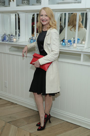 Patricia Clarkson injected a bright pop with a red foldover leather clutch.