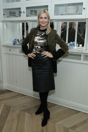 Black suede boots rounded out Kelly Rutherford's fall-chic look.