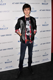 Nat Wolff rocked an edgy evening look with this fitted leather jacket, which he paired over a plaid shirt and graphic tee.