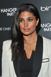 Rachel Roy always looks polished on the red carpet. She showed off her designer style and polished mane with a classic center part hairstyle.