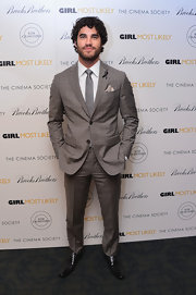 Darren Criss sported a light gray suit with plaid-print detailing while at the NYC screening of 'Girl Most Likely.'