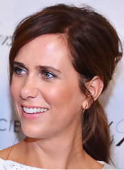 Kristen Wiig pulled back her auburn tresses into a teased ponytail while out at the NYC screening of 'Girl Most Likely.'