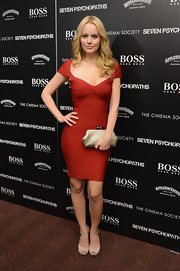 Va-va-voom... Helena Mattsson shows off her curves in this lipstick red bandage dress.