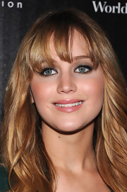 Jennifer Lawrence wore shimmering neutral shadows to create her smoky-eyed look for a screening of 'The Hunger Games.'