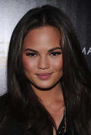 Chrissy Teigen polished her lips with a rosy pink gloss for a screening of 'The Hunger Games.'