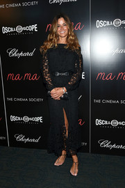 Kelly Bensimon donned a black lace dress with a high front slit to the screening of 'Ma ma.'
