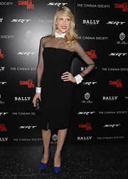 Lucy Punch added some color to her outfit with a pair of blue platform pumps.