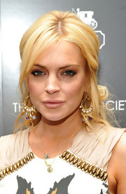 Lindsay Lohan stepped out for the premiere of 'Source Code' with gold hoop earrings complete with decorative beading.