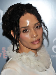 Lisa Bonet added a hint of soft rosy lip balm.