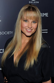 Genevieve Morton looked youthful with her long straight 'do and bangs at the screening of 'Henry's Crime.'