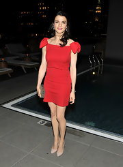Rachel Weisz teamed her flirty red cocktail dress with classic nude pumps at a screening of 'The Whistleblower.'