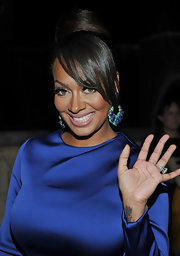 La La Anthony wore a dramatic high bun with side-swept bangs when she attended the screening of 'Restless.'