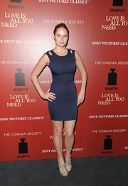 Genevieve Morton's navy frock totally showed off her curves at the 'Love Is All You Need' screening.