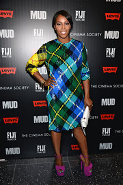 June Ambrose made a bold fashion statement on the red carpet with this blue, green, and yellow Tartan-plaid dress.