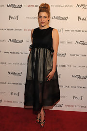 Greta Gerwig looked innovative at the screening of 'To Rome with Love' in an LBD with a sheer skirt and waist ruffles.