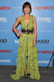Carla Gugino completed her look with black cross-strap platform sandals.