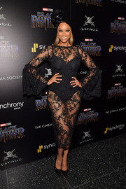 Tyra Banks flaunted her killer figure in a sheer lace dress at the screening of 'Black Panther.'
