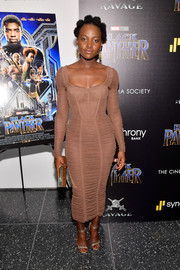 Lupita Nyong'o looked captivating in a ruched nude corset dress by Dolce & Gabbana at the screening of 'Black Panther.'