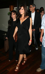 Gina Gershon's red strappy sandals and little black dress were a super-sexy pairing.
