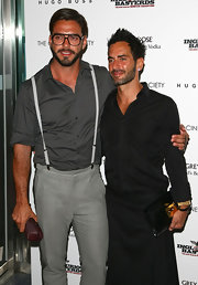 Marc Jacobs showed off his patent leather clutch while walking the red carpet.
