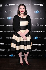 Stephenie Meyer paired a basic cardigan over a striped dress for a retro-styled red carpet look.