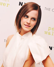 Emma Watson's short hair has edgy layers that give it a high-fashion look.