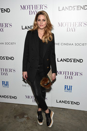 Olivia Palermo rounded out her look with on-trend platform oxfords by Stella McCartney.