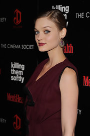 Bella Heathcote styled her NYC premiere of 'Killing Them Softly' with a pair of green and pink sapphire earrings.