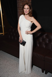 Going McQueen all the way, Julianne Moore accessorized with a gemstone-inlaid black clutch.