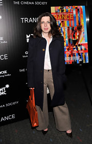 Heather Matarazzo chose a knee-length wool coat to pair with her wide-leg pants, which gave her a totally preppy evening look.