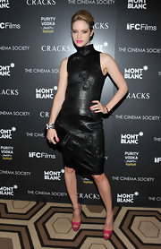 Julie got racy in a little black dress with leather appliqued florets for the screening of 'Cracks.'