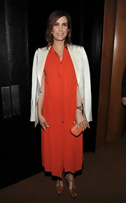 Kristen Wiig wore this drop-waist orange dress for the 'Friends With Kids' after-party,