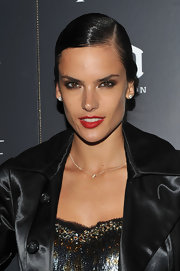 Alessandra Ambrosio paired her sleek bun with classic red lips. The perfect combo of edge and glamour!