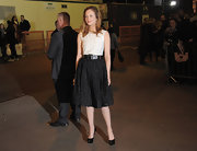 Andrea Riseborough kept her accessories simple, opting for black leather platform pumps.