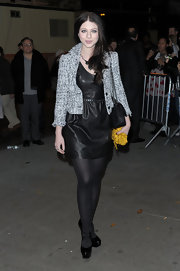 Michelle Trachtenberg gave her leather dress a ladylike finish with the addition of a black-and-white tweed jacket.