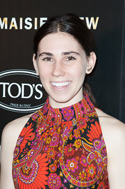 Zosia Mamet kept her evening look low maintenance with a simple parted pony.